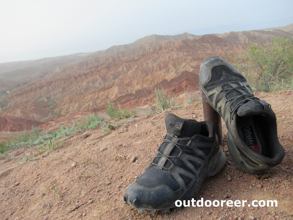 Salomon trekking shoes vegan friendly label on Kazakhstan landscape