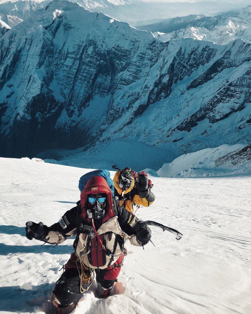 Black Diamond Cobra Ice tool used while climbing a mountain