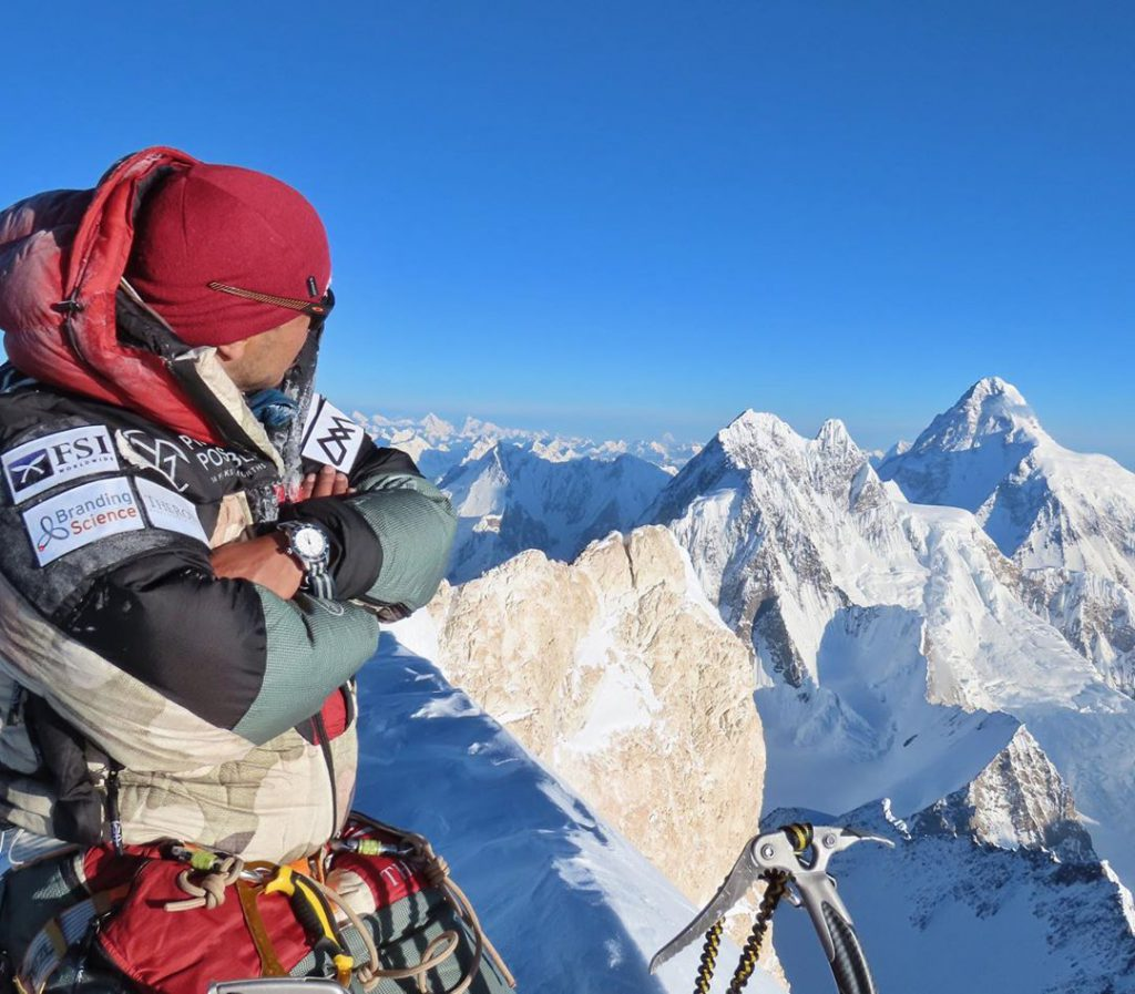 Nirmal Purja at the peak of the mountain with his cobra ice tool  black diamond