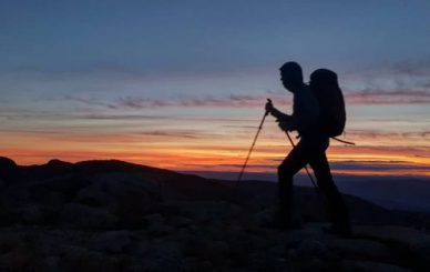 James Forrest Mountain Men / hiking with poles during sunset